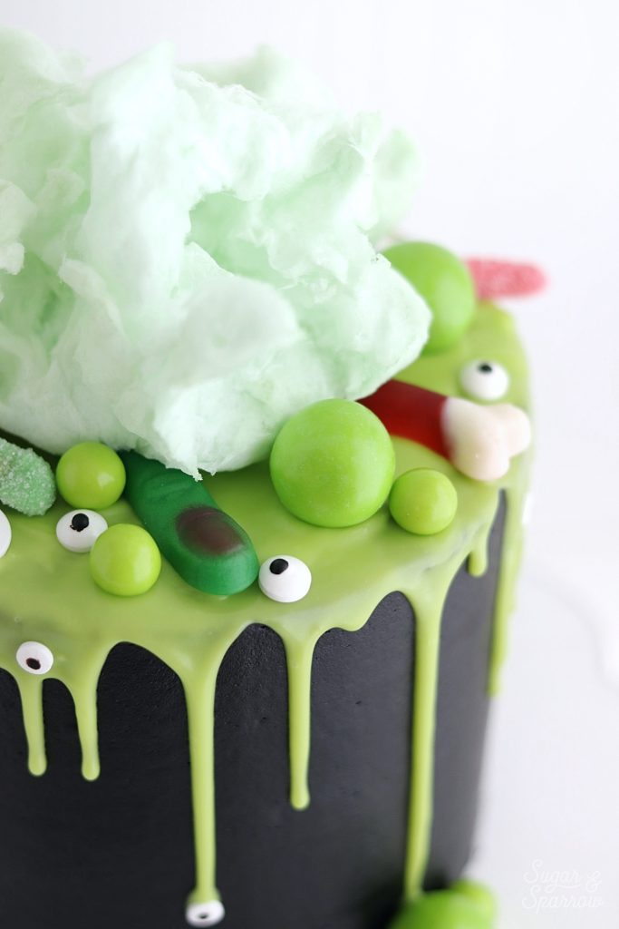 Witch cauldron cake topped with cotton candy