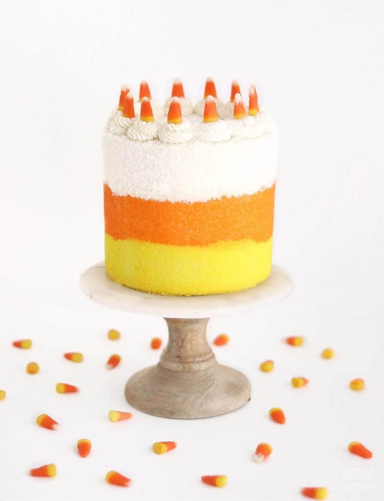 candy corn halloween party cake by sugar and sparrow