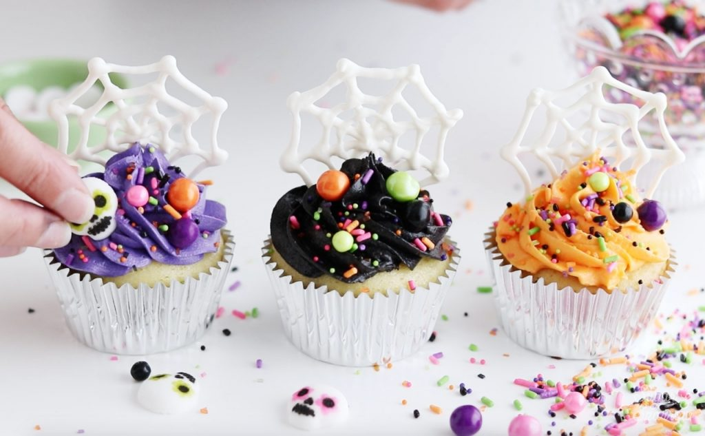 Halloween cupcakes with spiderwebs and sprinkles