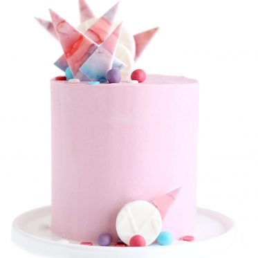 fondant cake decorations on buttercream cake by Sugar and Sparrow