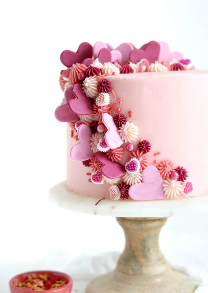 pink valentines day cake with hearts