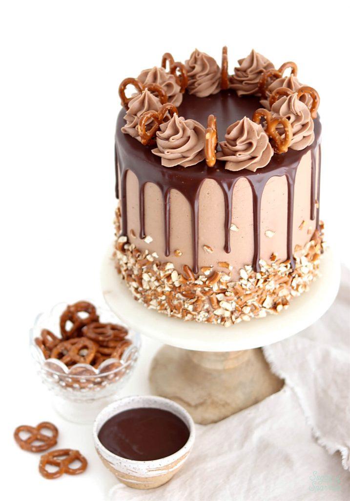 pretzel cake recipe with nutella buttercream and nutella ganache drip cake