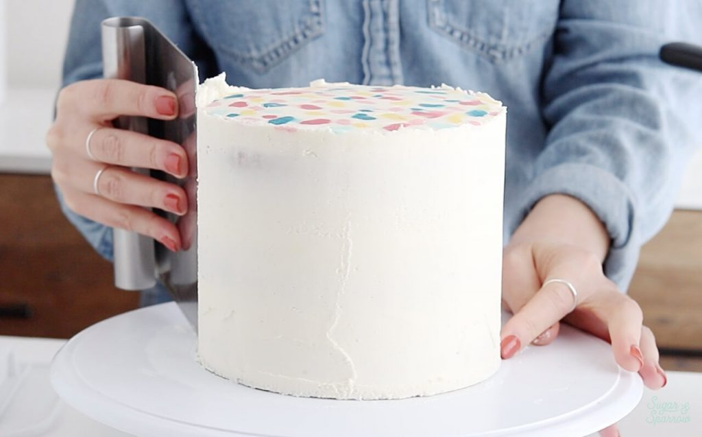 frosting the sides of cake