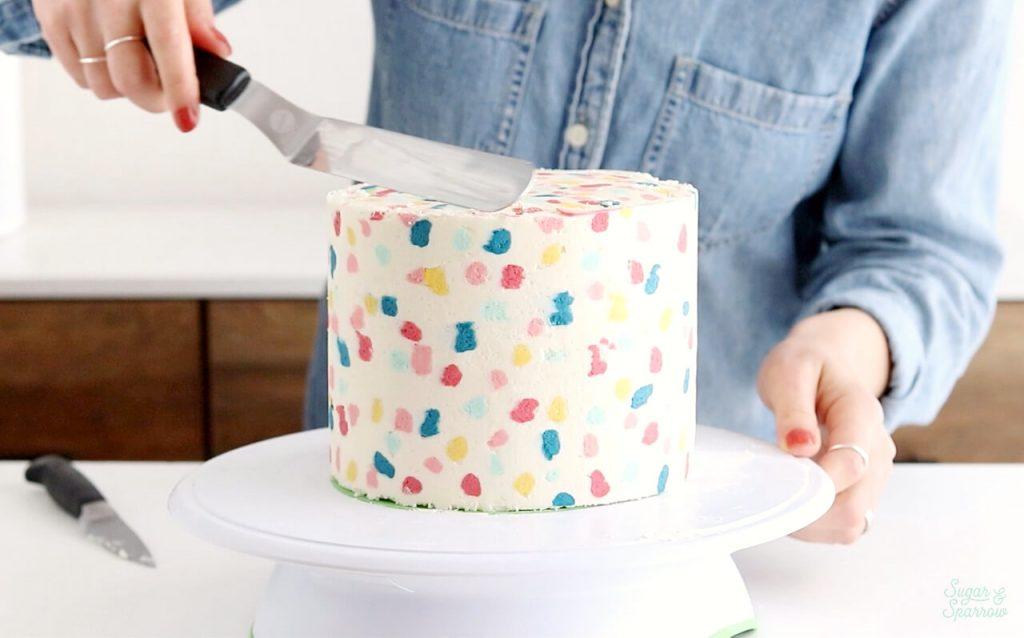 buttercream cake covered in terrazzo