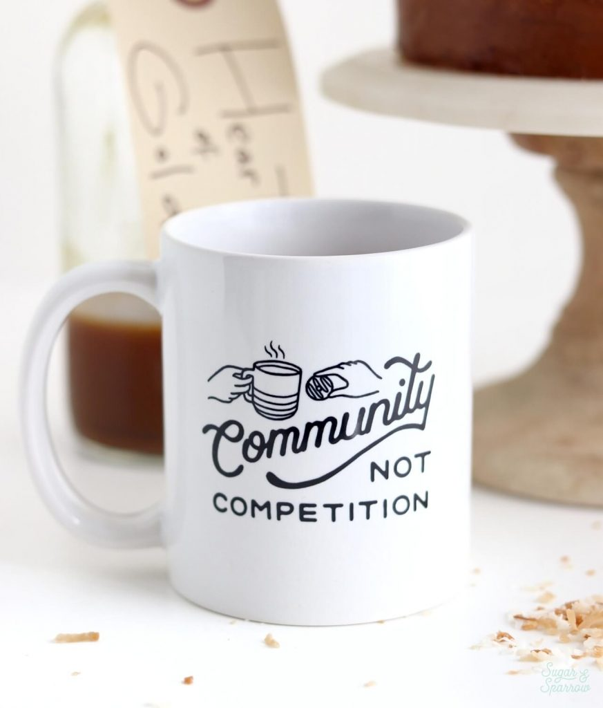 Community Not Competition coffee mug by Pip's Original