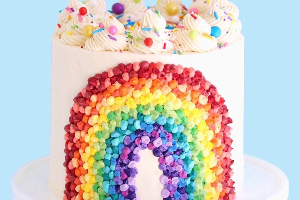 rainbow cake with buttercream by sugar and sparrow