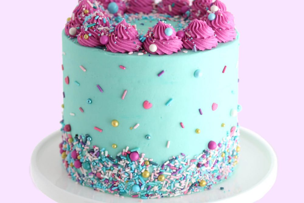 birthday cake with sprinkles by sugar and sparrow