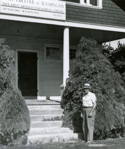Superintendent Overley standing at the base of the steps to the original building.