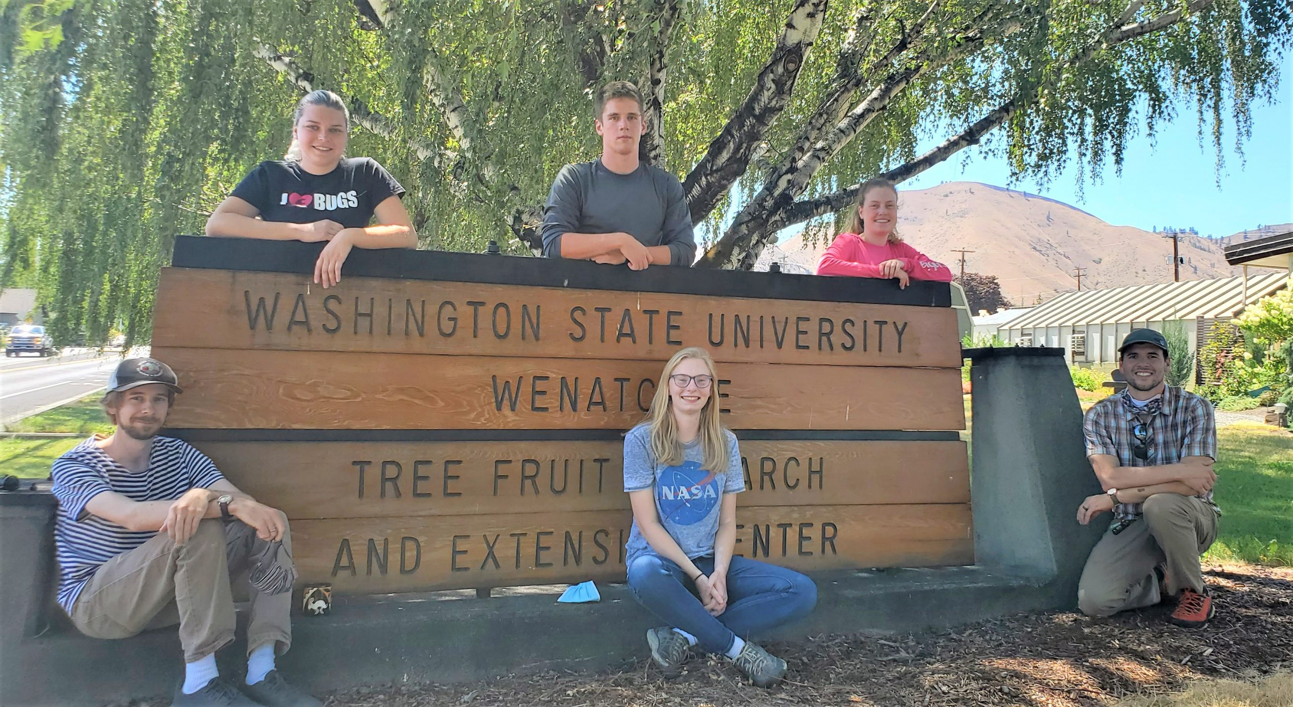 2020 Lab Crew, 6 people posed by the WSU TFREC sign