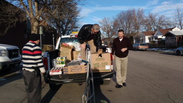 City employees donated boxes of canned food collected in their annual food drive.