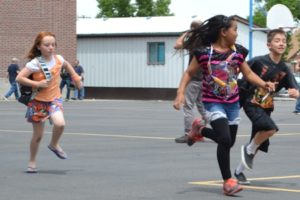 Students running across the playground.