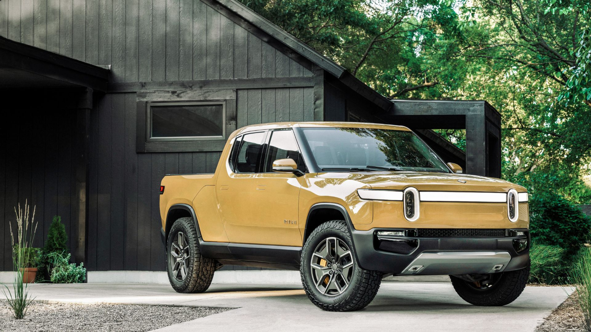 Rivian's R1T showing off in a gorgeous sand color.