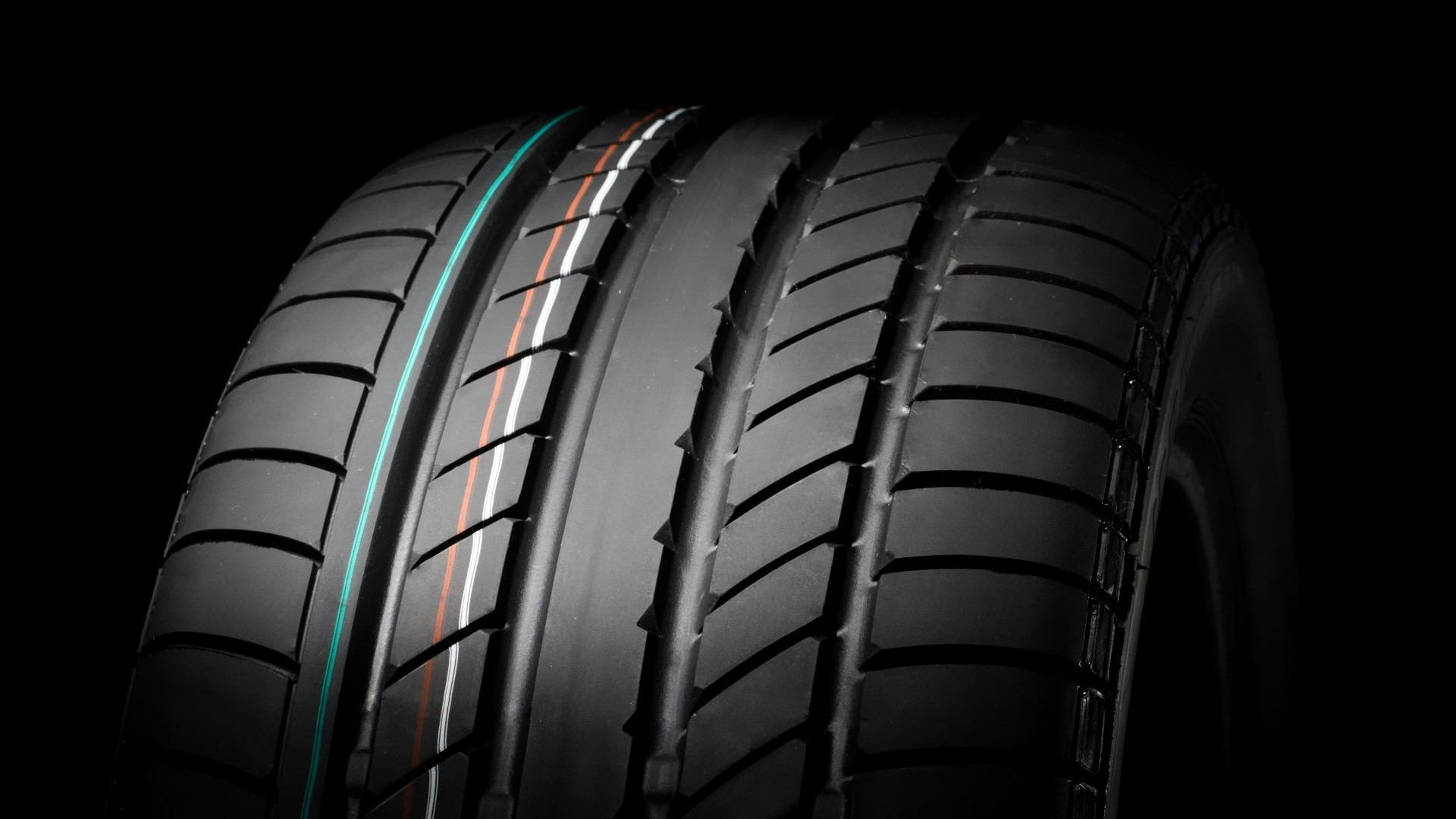An up-close view of the tread on a summer tire.