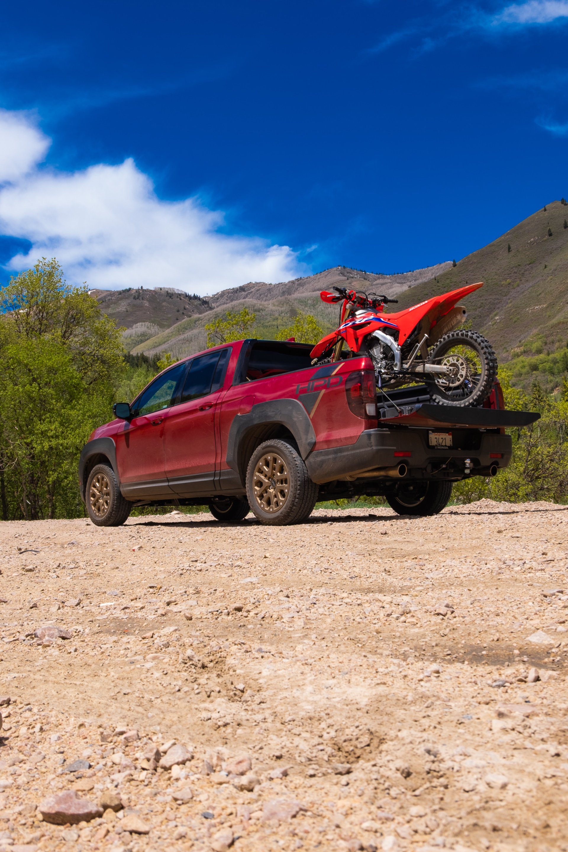 The Ridgeline with a CRF450RX in the bed.