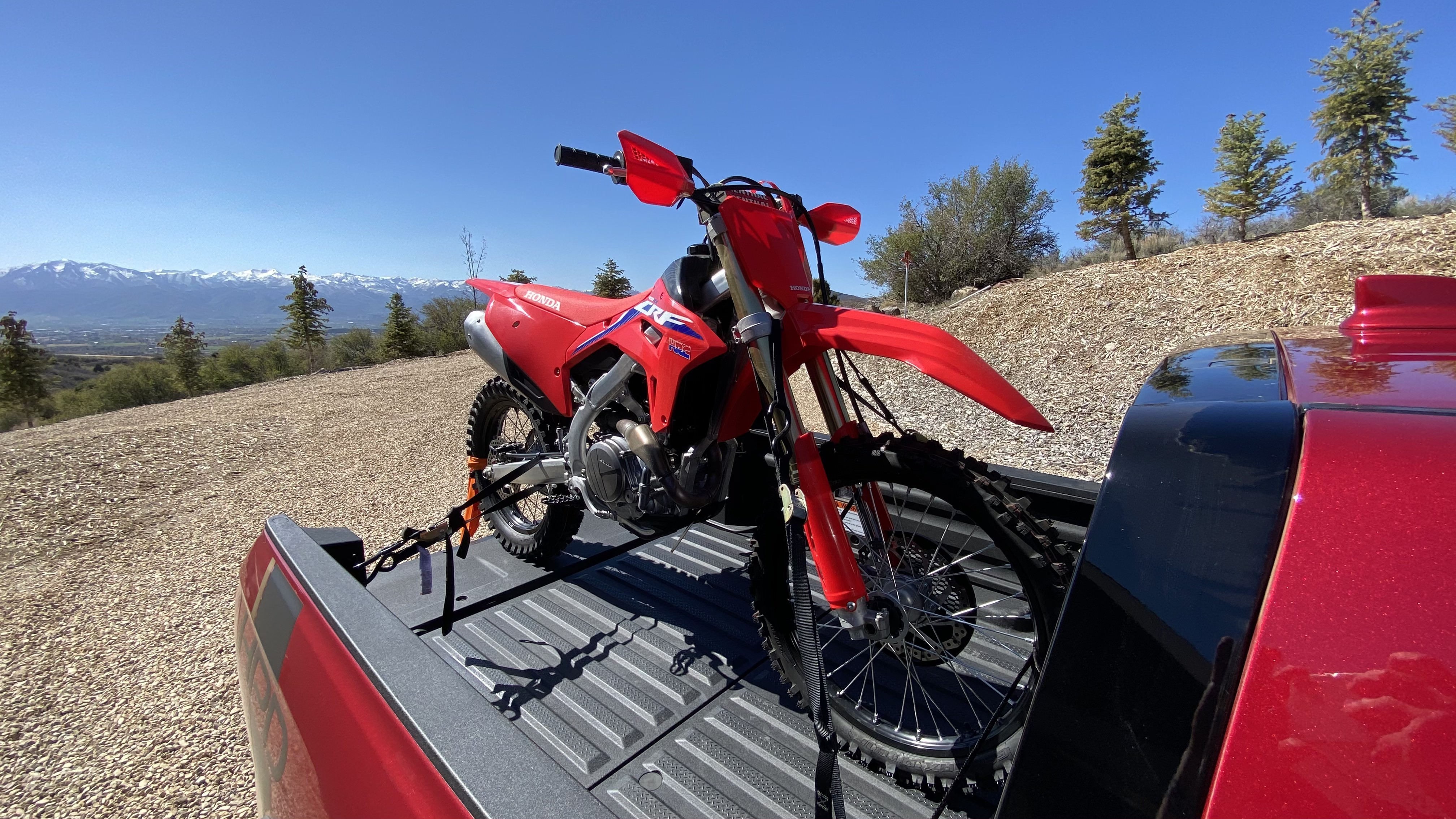 A closeup shot of the CRF450RX in the pickup's bed.