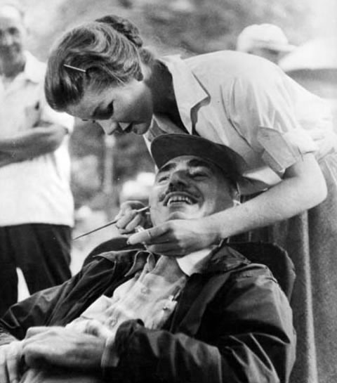 "Dolores Hart touches up John Alton on set of ""Lonelyhearts."""