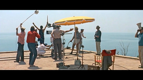 "Final scene of ""Contempt"" Lang standing behind camera, Godard, middle right with arms akimbo."