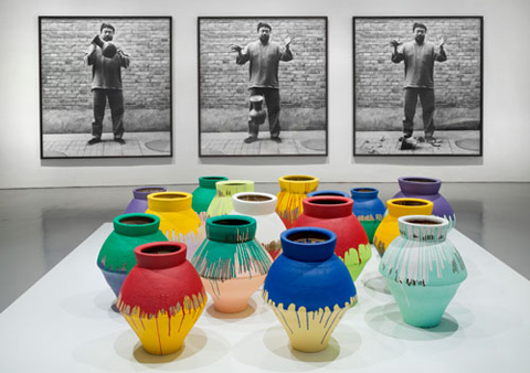 """Photomural, """"Dropping a Han Vase"""" and painted vases."""