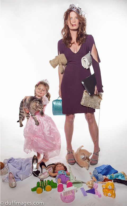 Promotional still of the harried mom with blissful daughter, Natalia.