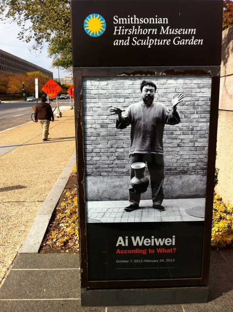 Exhibition poster outside museum entrance.