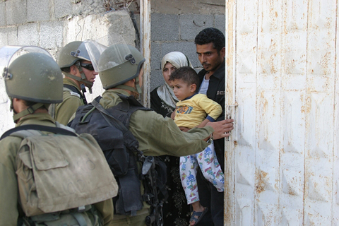 IDF forces try to enter Emad's home.