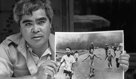 Nick Ut holding the iconic photographed that helped end the Vietnam War.
