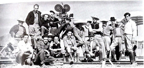 Figueroa in sombrero sitting on the dolly,  Maclovia? crew photo.