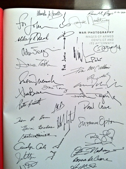 Exhibition catalog, signed title page by three dozen attending photographers.