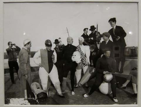 """Cast and crew photo for """"Triadic Ballet."""" Schlemmer in center, in black, holding doll's head."""