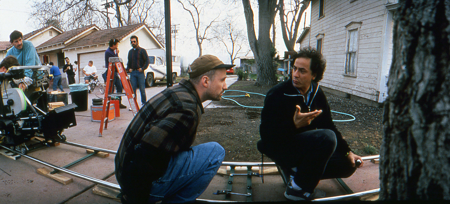 Director David Fincher (left) and Darius Khondji, AFC plot a dolly shot during the production. This scene, a prologue sequence involving Somerset, was ultimately cut from the film.