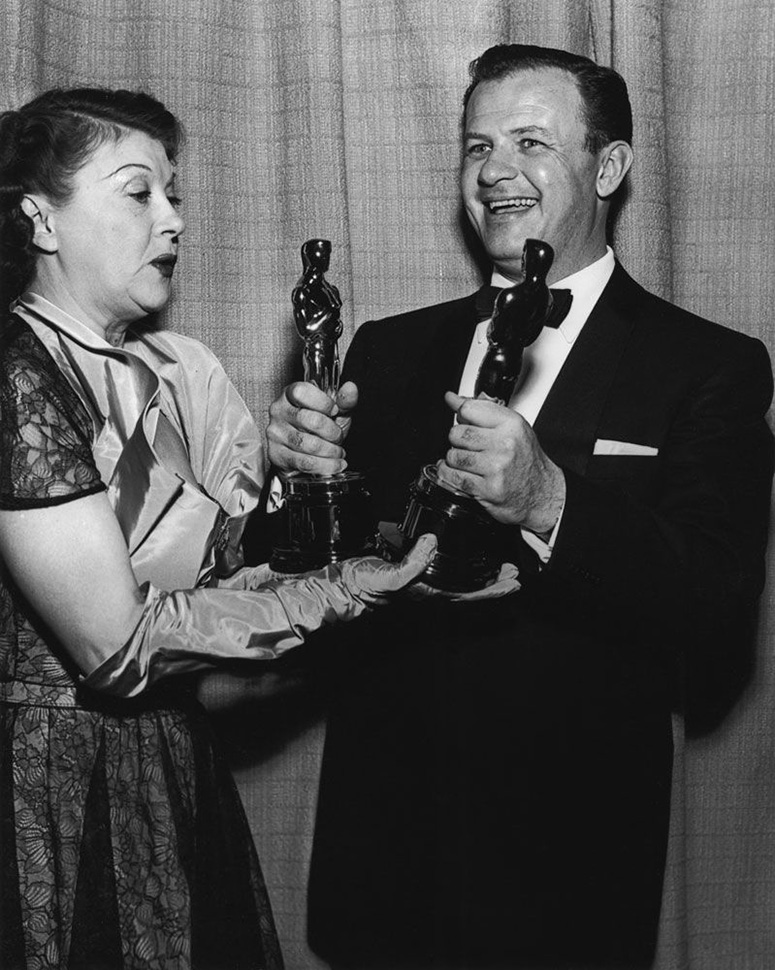 Joseph L. Mankiewicz with his Oscars for writing and directing All About Eve.