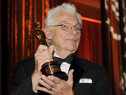 Willis with his honorary Academy Award in 2009.