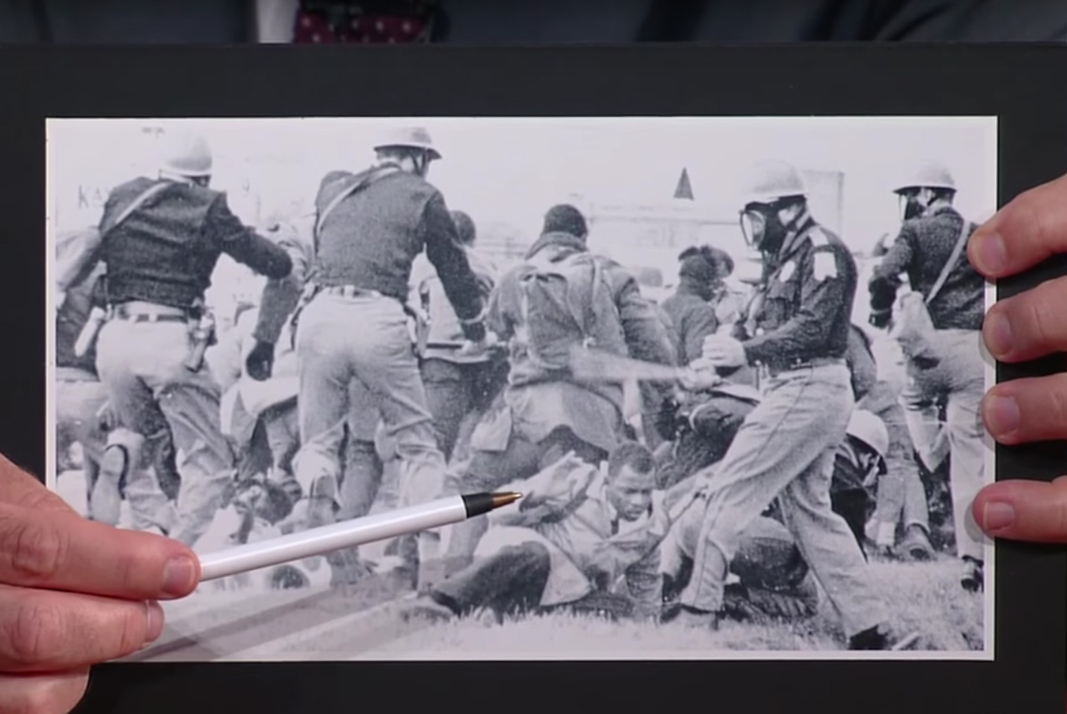 """Colbert points to Lewis in an archival photo of """"Bloody Sunday."""""""