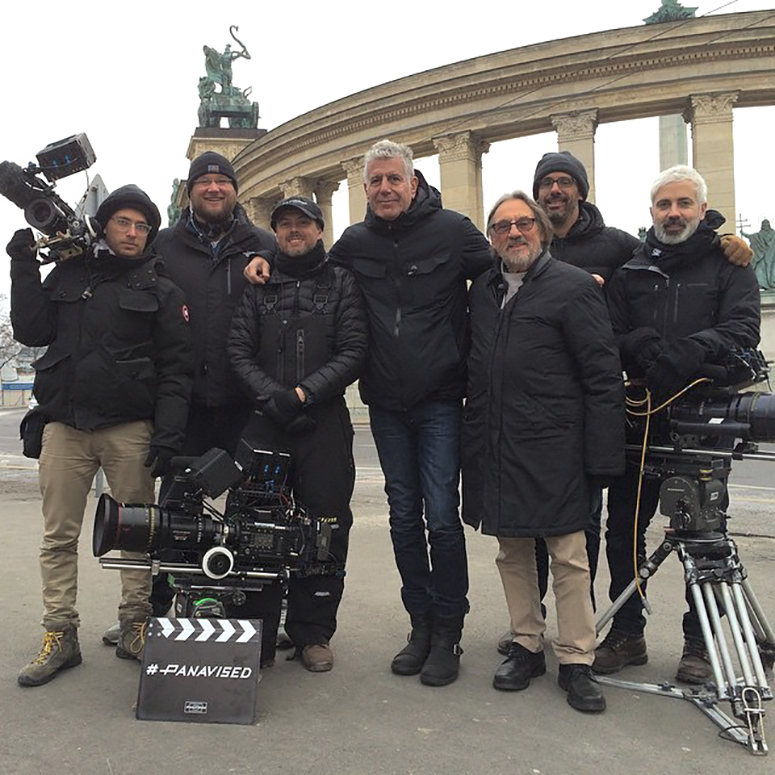 Vilmos poses with Bourdain and the Parts Unknown crew.