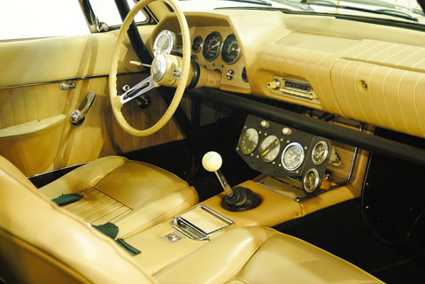 The interior of the Avanti. Except for the roll bars, the car is stock and includes a radio and heater.