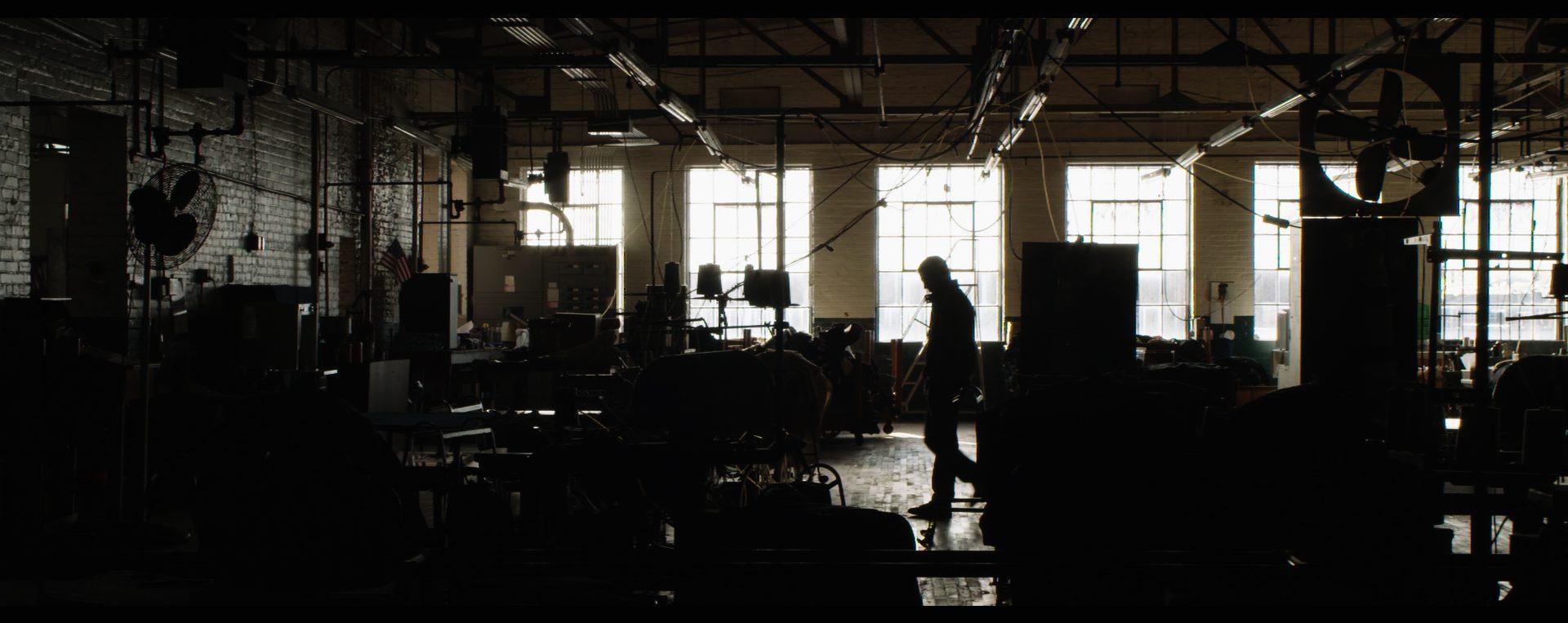 Actor Ryan O'Quinn walks through the deserted warehouse set.