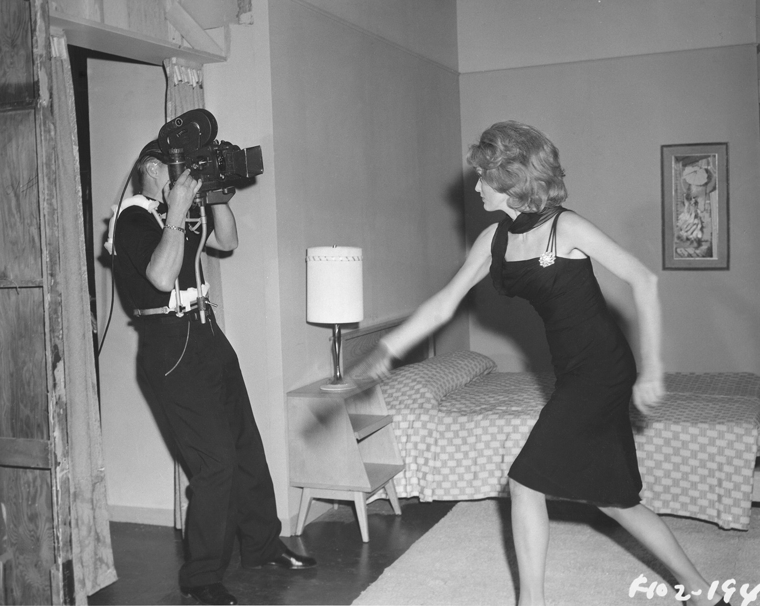 Filming actress Constance Towers for The Naked Kiss (1964). (Credit: Margaret Herrick Library)