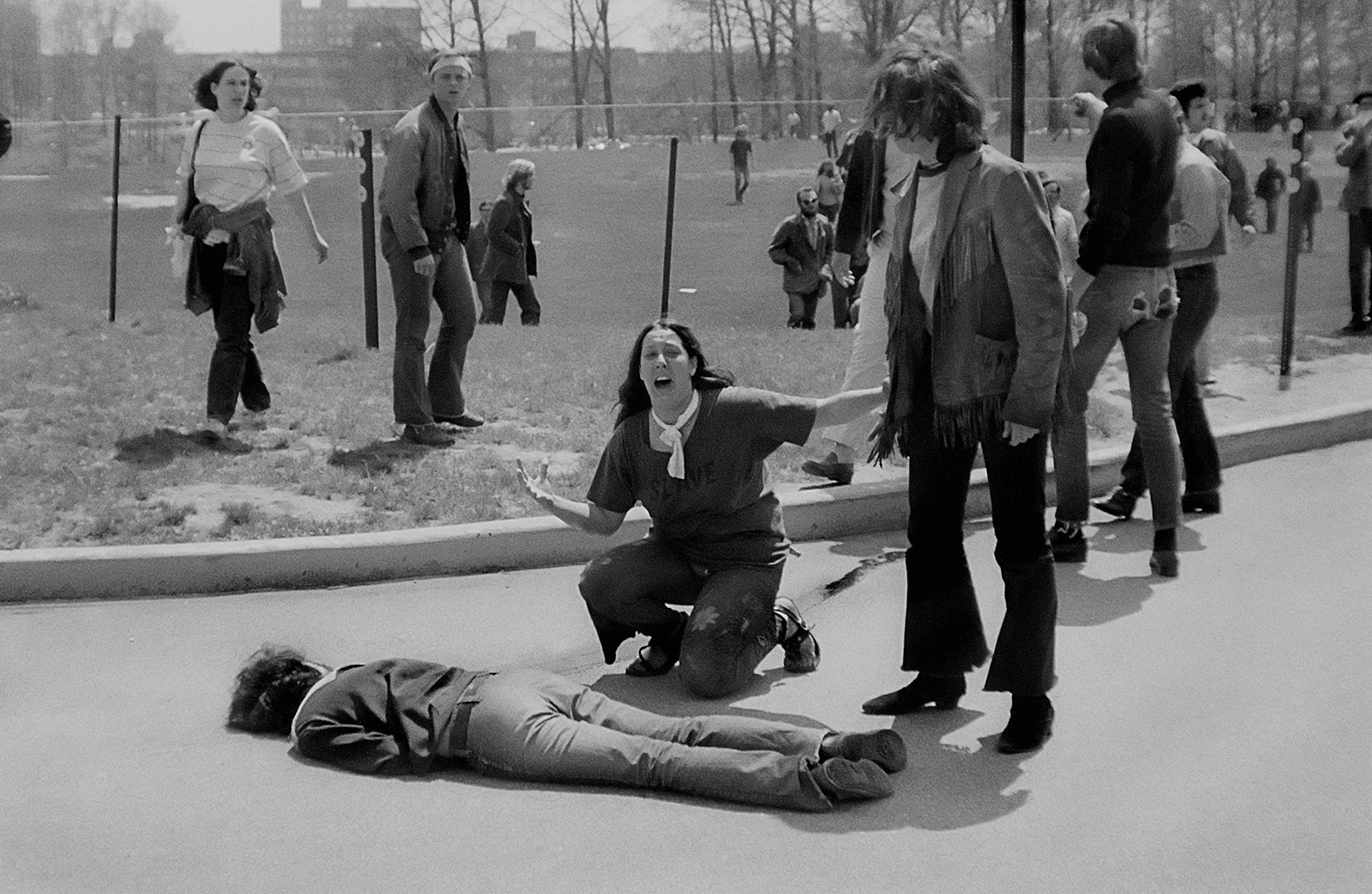 Mary Ann Vecchio cries out over the body of Jeffrey Miller at Kent State University on May 4, 1970. ©1970 John Paul Filo. All Rights reserved.