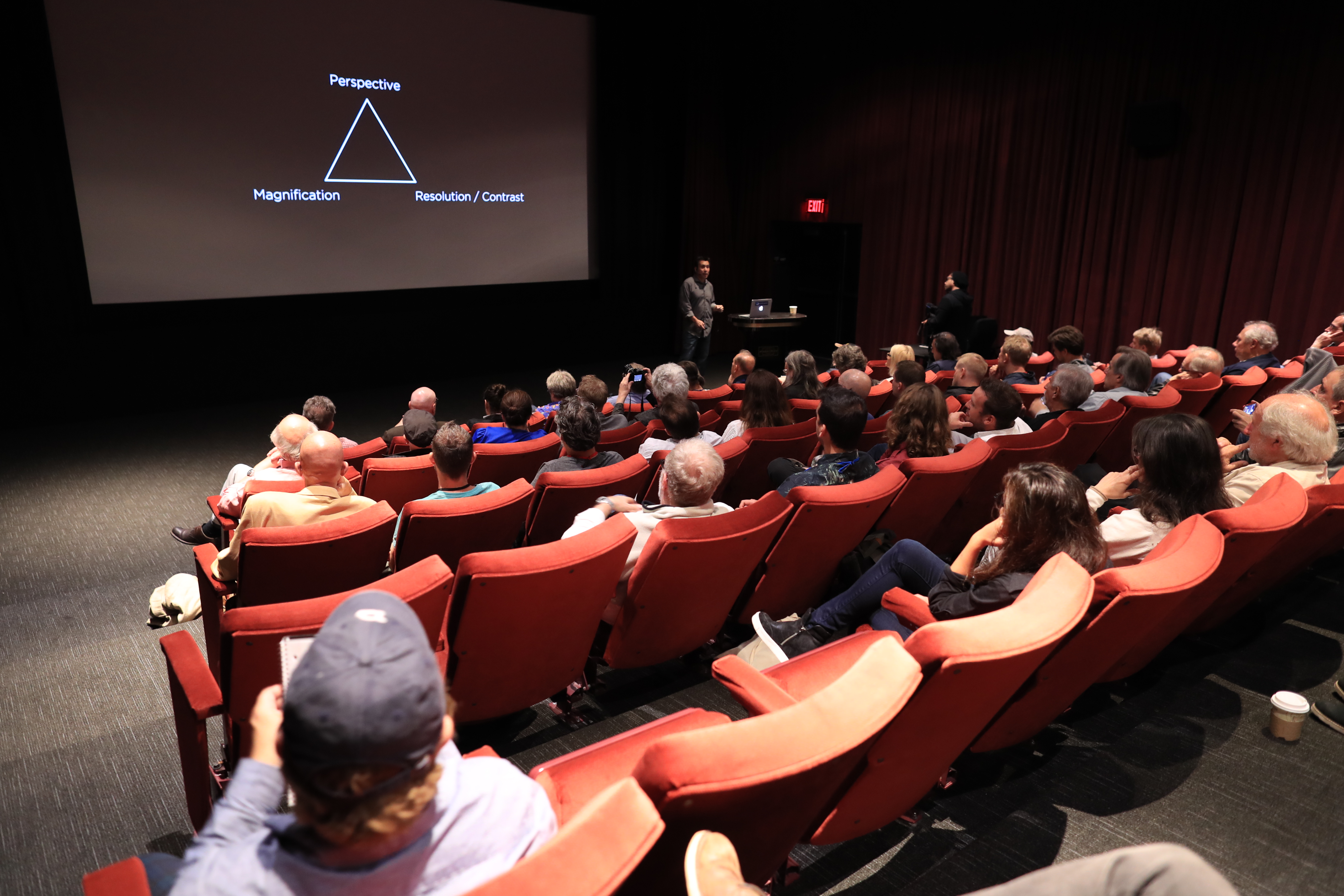 Dan Sasaki, Panavision's Vice President of Optical Engineering, leads the discussion at the Tak Miyagishima Theater. Photo by James Neihouse, ASC