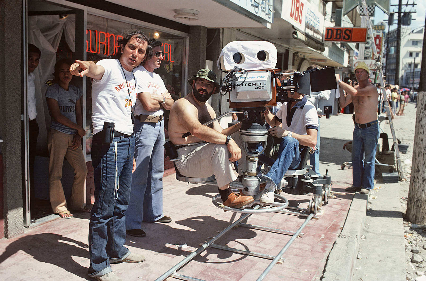 On location in the Philippines, Storaro makes a point to his crew, with Coppola at the eyepiece.