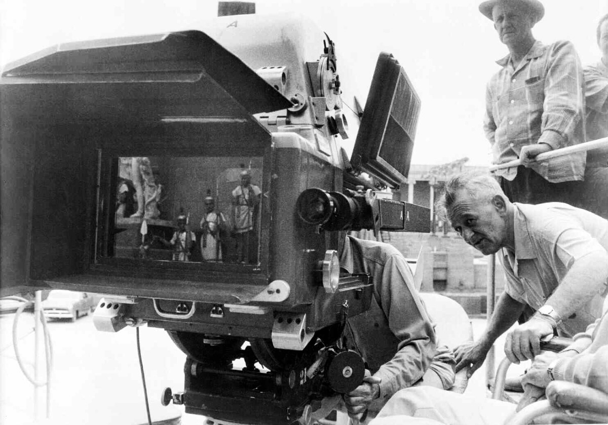 Robert Surtees, ASC (standing) observes while director William Wyler leans in to check the frame while shooting Ben-Hur (1959) in 65mm.