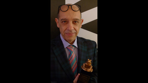 Bruno at Camerimage with his Bronze Frog. Photo by Benjamin B for thefilmbook.