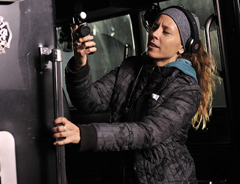 Lisa Wiegand, ASC, at work on the set. (Credit: NBC Universal)