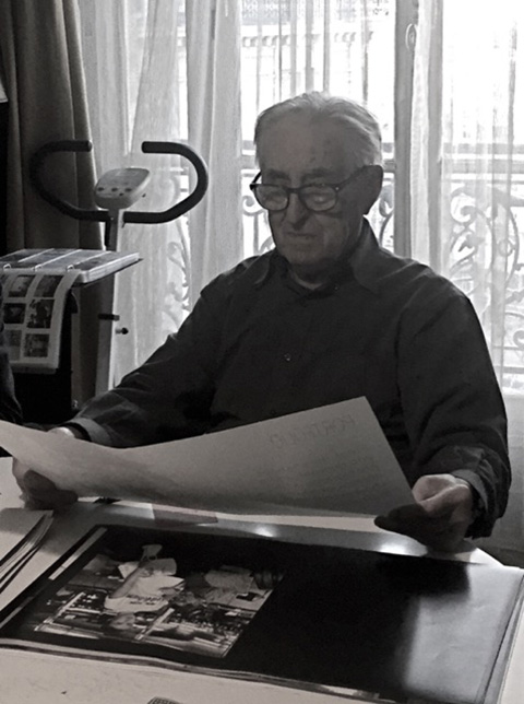 Raymond Cauchetier at home in 2015, examining proofs for his new monograph. (Credit: James Smith)