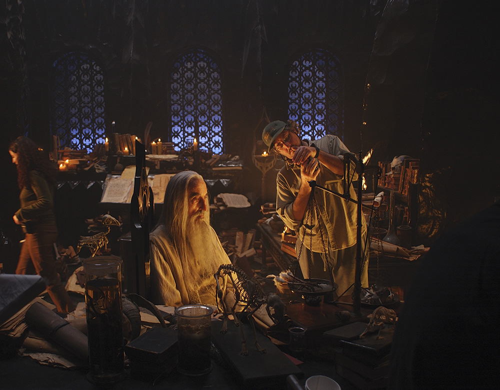 Lesnie checks the light on the villainous Saruman (Christopher Lee) for The Lord of the Rings: The Two Towers. (New Line Cinema)