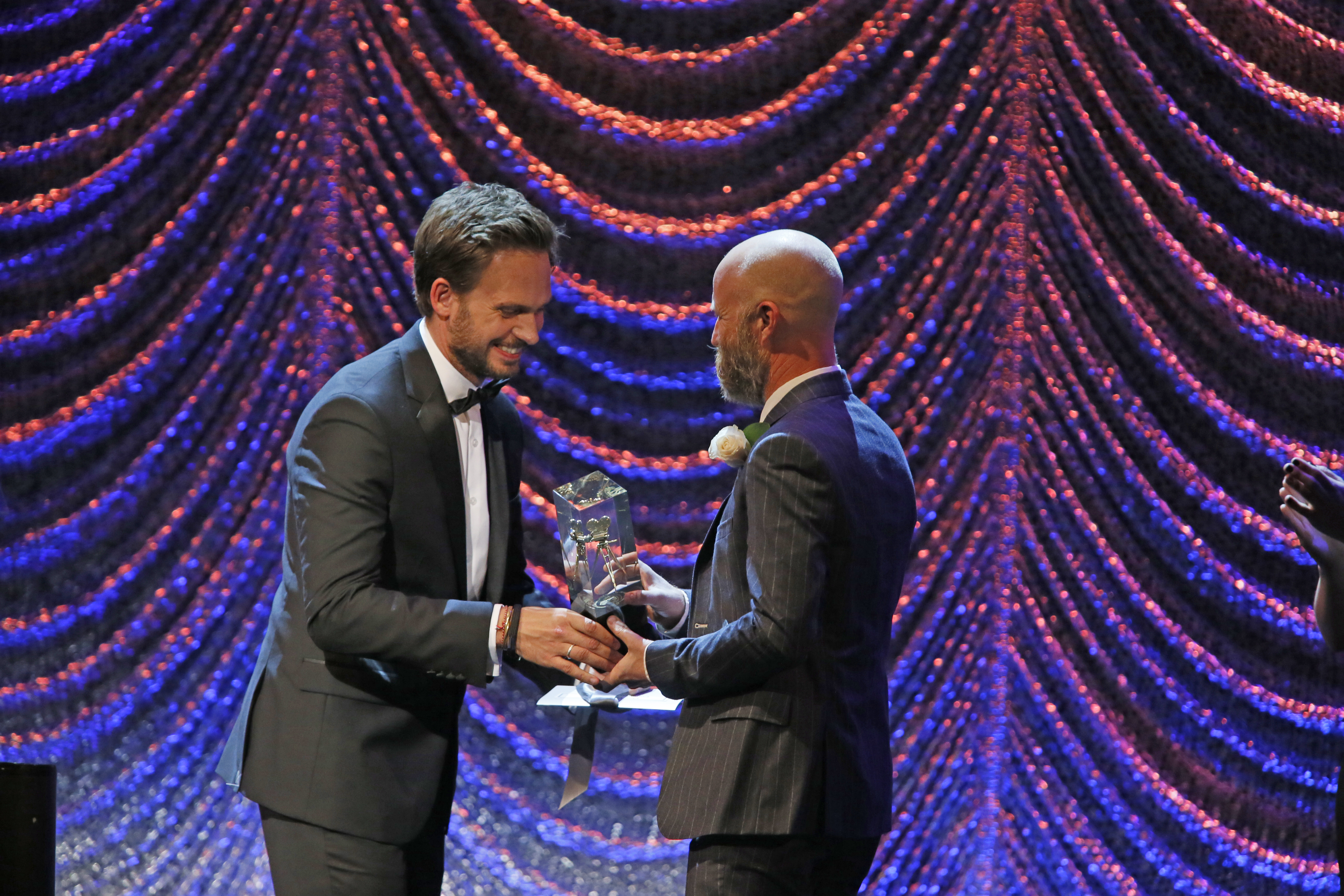 """Patrick Adams presents to winner Tod Campbell for """"Mr. Robot."""""""
