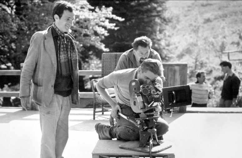 Francois Truffaut looks on as Raoul Coutard kneels on Western Dolly on set of  Jules and Jim - credit Raymond Cauchetier