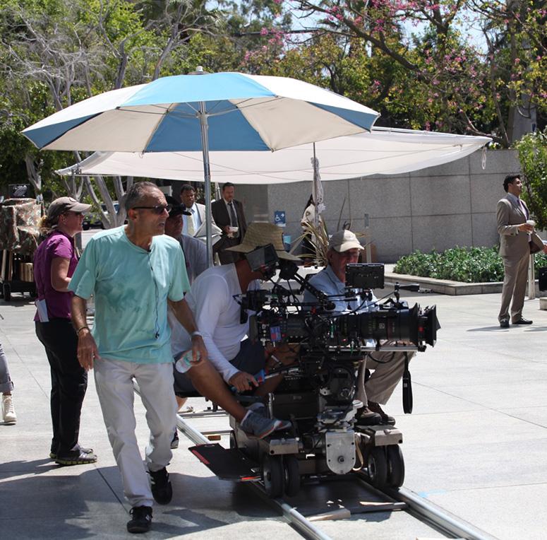 Makris (left, wearing green shirt) directs an episode of Secrets and Lies.