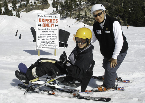 Jack and his Marine Corps ski student give the thumbs up at the Disabled American Veterans Winter Sports Clinic.