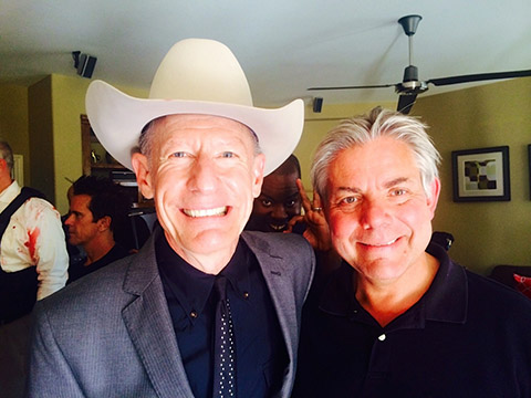 Szalay poses with THE BRIDGE guest star Lyle Lovett.